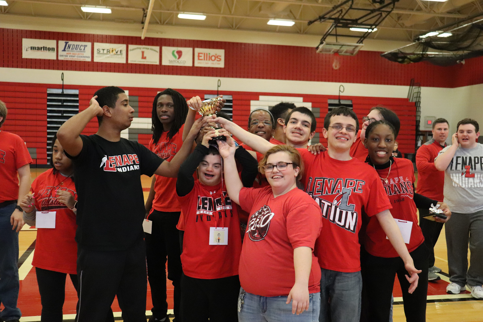 Lenape students holding a trophy.