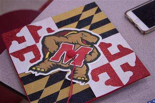 Lenape graduation cap decorated in University of Maryland colors, red, black and yellow.