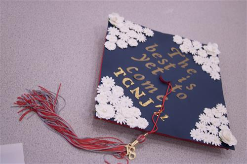 Lenape graduation cap decorated for The College of New Jersey.