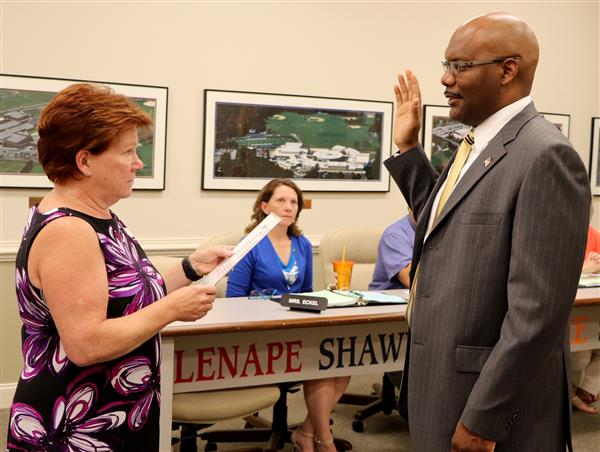 Board member being sworn in